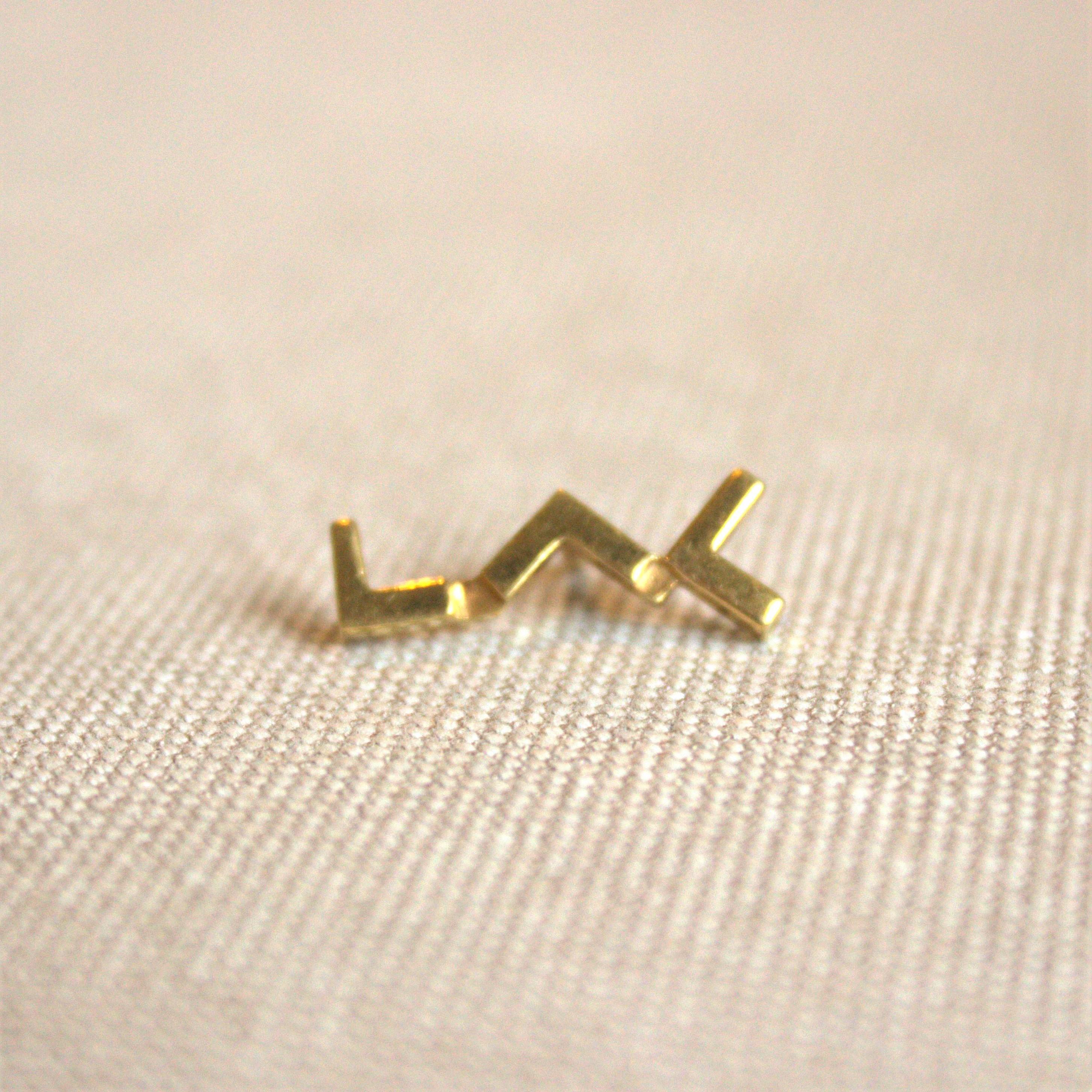 pin's en argent plaqué or au logo du LAC